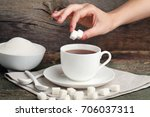 female hand throwing sugar... | Shutterstock . vector #706037311