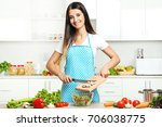 beautiful young woman cooking... | Shutterstock . vector #706038775