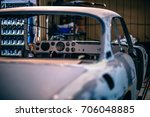 classic car is in a workshop... | Shutterstock . vector #706048885