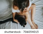 young woman with a black cat | Shutterstock . vector #706054015