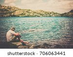 man sitting on a small island | Shutterstock . vector #706063441