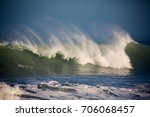 wind whipped spray rise high... | Shutterstock . vector #706068457