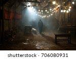 man in black hat in the rain at ... | Shutterstock . vector #706080931