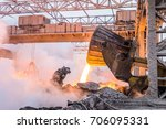 pouring the red hot melt by... | Shutterstock . vector #706095331