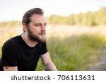laid back bearded man wearing a ... | Shutterstock . vector #706113631