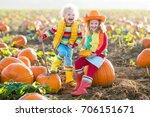 little girl and boy picking... | Shutterstock . vector #706151671