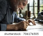 closeup of senior man writing... | Shutterstock . vector #706176505