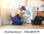 working man plumber repairs a... | Shutterstock . vector #706180579