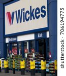 Small photo of Bourne Retail Park, Salisbury, Wiltshire, England - August 28, 2017: Wickes sign above entrance, British home improvement retailer, sales of supplies and material to the public and the building trade