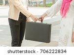 arab  businesswoman holding bag ... | Shutterstock . vector #706222834