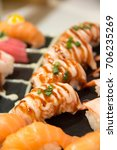sushi served on plate japanese... | Shutterstock . vector #706235269