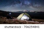 man hiker enjoying night scene... | Shutterstock . vector #706254841