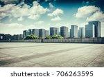 asphalt road and modern city | Shutterstock . vector #706263595