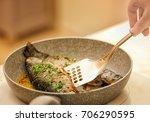 chef preparing delicious fishes ... | Shutterstock . vector #706290595