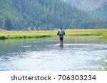 fly fisherman fishing in... | Shutterstock . vector #706303234
