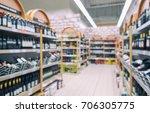 blurred racks with bottles of...   Shutterstock . vector #706305775
