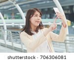 portrait of a young asia woman... | Shutterstock . vector #706306081