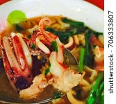 crushed shrimp face squid | Shutterstock . vector #706333807