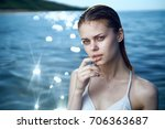 beautiful  young woman with wet ... | Shutterstock . vector #706363687