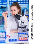 laboratory female assistant... | Shutterstock . vector #706379209
