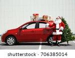 Authentic Santa Near Red Car...