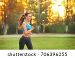 young sporty woman running in... | Shutterstock . vector #706396255