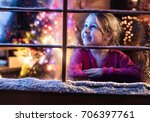on christmas night a little... | Shutterstock . vector #706397761
