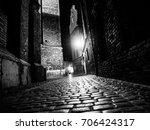 Illuminated Cobbled Street Wit...
