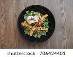 fresh salad on wooden table ... | Shutterstock . vector #706424401
