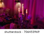 three candles creating a cozy... | Shutterstock . vector #706453969