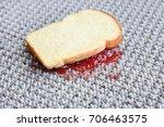 sandwich with jam on carpet | Shutterstock . vector #706463575