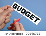 Scissors cutting the word budget concept for recession or credit crisis - stock photo