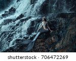 the real mermaid is resting on... | Shutterstock . vector #706472269