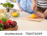 chef giving cooking classes in... | Shutterstock . vector #706476349