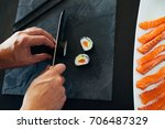 sushi being cut on a board   Shutterstock . vector #706487329