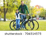 dad and son standing with their ... | Shutterstock . vector #706514575