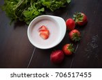 strawberry yoghurt on wooden... | Shutterstock . vector #706517455