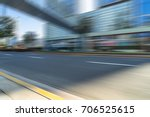 empty asphalt road front of... | Shutterstock . vector #706525615