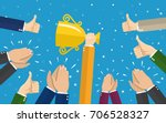 businessman holding up a... | Shutterstock .eps vector #706528327