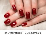 bright festive red manicure on... | Shutterstock . vector #706539691