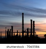 Refinery plant over a beautiful sunset sky. - stock photo