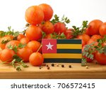 togolese flag on a wooden panel ... | Shutterstock . vector #706572415