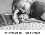 young mother happy newborn child | Shutterstock . vector #706599805