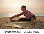 mature woman doing gymnastic...   Shutterstock . vector #706617037