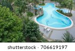 swimming pool aerial view | Shutterstock . vector #706619197