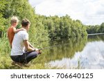 father and son fishing at the... | Shutterstock . vector #706640125