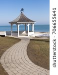 a white gazebo with a wood... | Shutterstock . vector #706655641