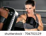serious female boxing athlete... | Shutterstock . vector #706702129