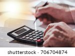 male hand using calculator ... | Shutterstock . vector #706704874