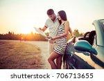 young couple next convertible... | Shutterstock . vector #706713655
